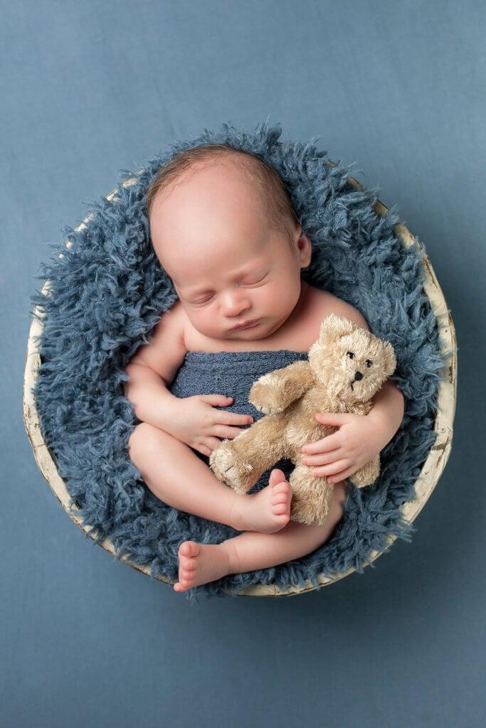 Photographers photo of newborn baby boy with teddy bear for boy in Denver, Colorado