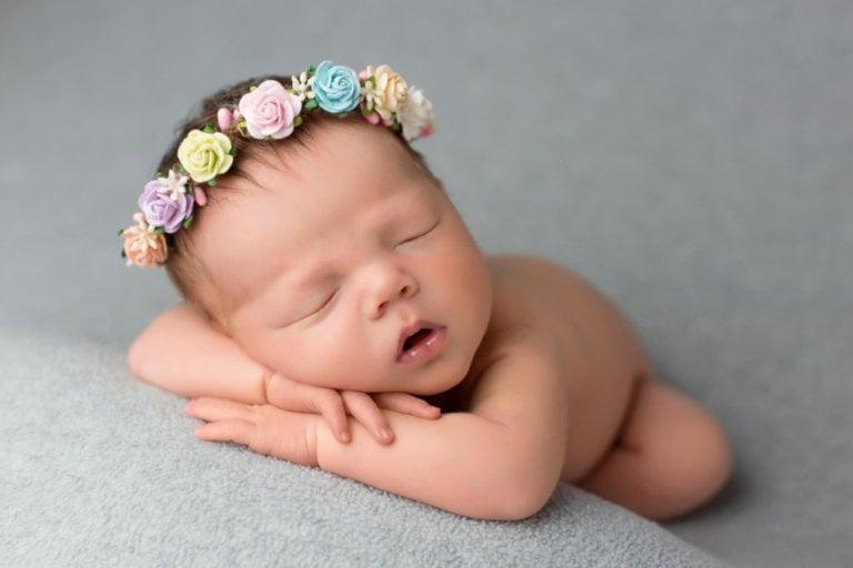 Baby newborn girl with flower headband for girl in Philadelphia, Pennsylvania