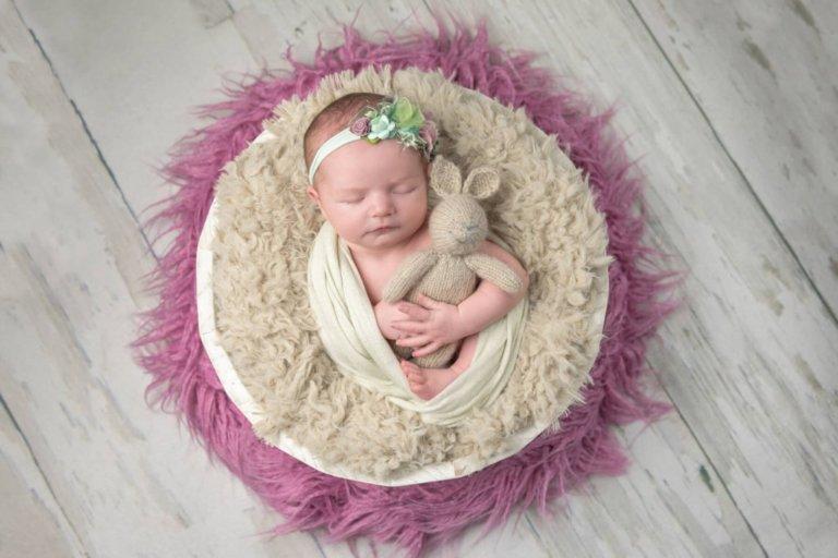 Baby holding stuffed bunny newborn photograph for girl in Philadelphia, Pennsylvania