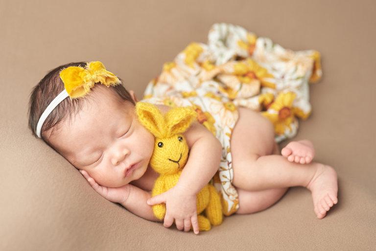 Girl in sunflower yellow with yellow bunny for girl in Philadelphia, Pennsylvania